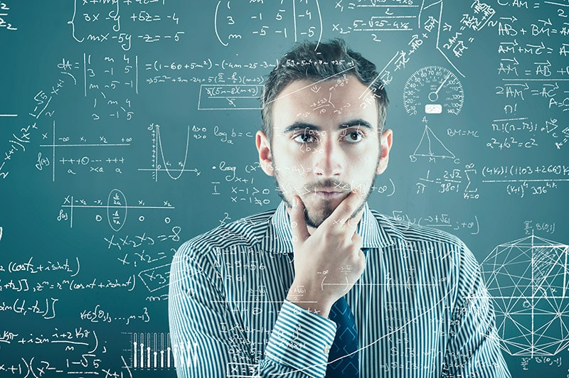 Data Scientist thinking over complex mathematical formulae